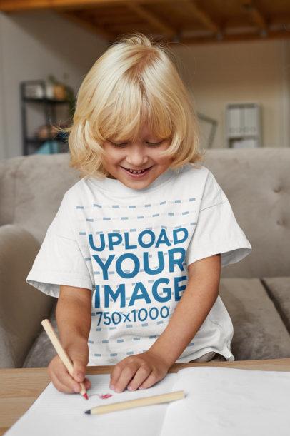T-Shirt Mockup of a Smiling Kid Drawing at Home 44289-r-el2