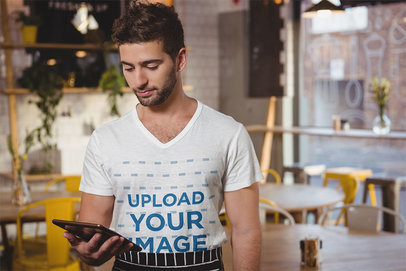 V-Neck Tee Mockup Featuring a Man Standing in a Restaurant 41495-r-el2
