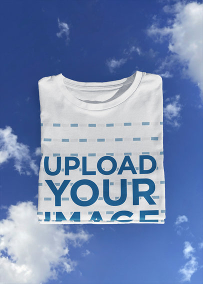 Folded T-Shirt Mockup Featuring a Blue Sky Reflection m606