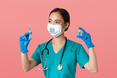 Face Mask Mockup of a Female Nurse Holding a Vaccine 44525-r-el2