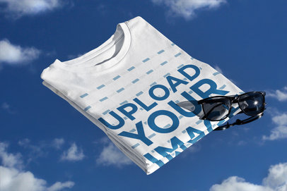 Mockup Featuring a Folded Tee and a Sky Background m612