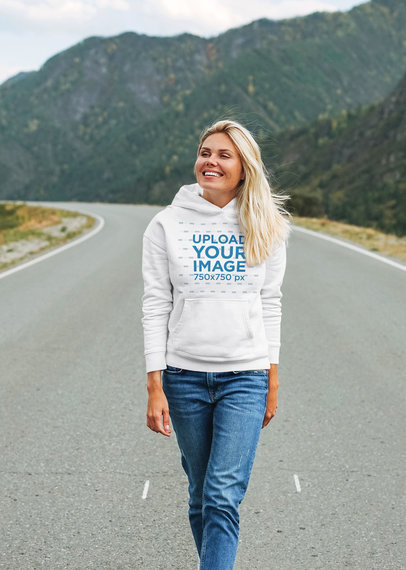 Hoodie Mockup of a Happy Woman Walking in the Middle of the Highway 44485-r-el2