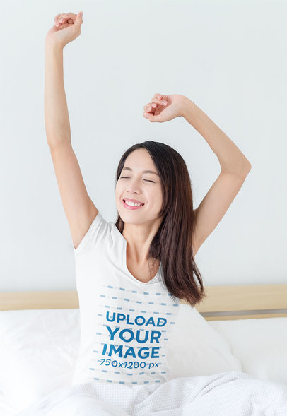 T-Shirt Mockup Featuring a Woman Stretching Her Arms on a Bed 41884-r-el2