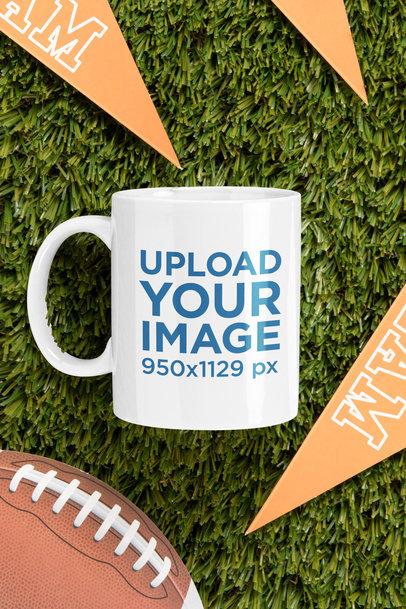 Mockup of an 11 oz Mug Placed by a Football Ball m348