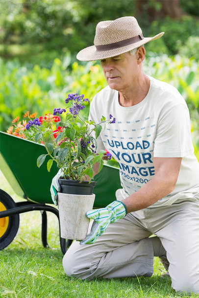 T-Shirt Mockup Featuring a Senior Man Planting Some Flowers 41463-r-el2