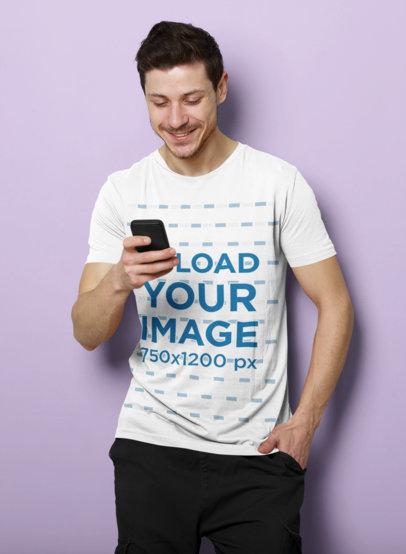 T-Shirt Mockup of a Man Checking His Phone in a Studio 40087-r-el2
