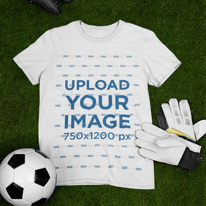 Mockup of a T-Shirt Laid Flat Next to Some Soccer Equipment m379