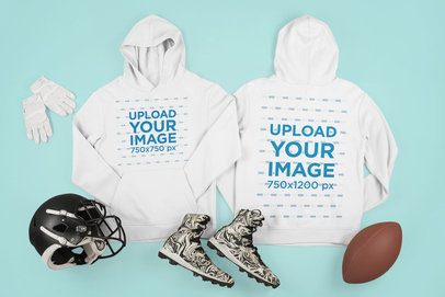 Mockup of Two Hoodies Surrounded by Football Gear m334