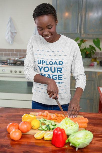 Crewneck Sweatshirt Mockup of a Young Woman Cutting Vegetables 44251-r-el2