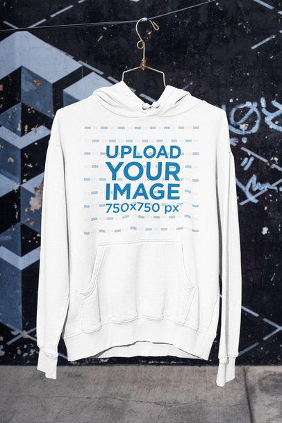 Mockup of a Pullover Hoodie Placed on a Hanger by a Street m444