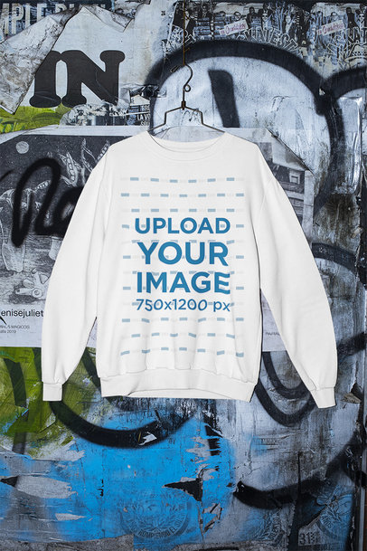 Mockup of a Sweatshirt Hanging by a Graffitied Wall m426