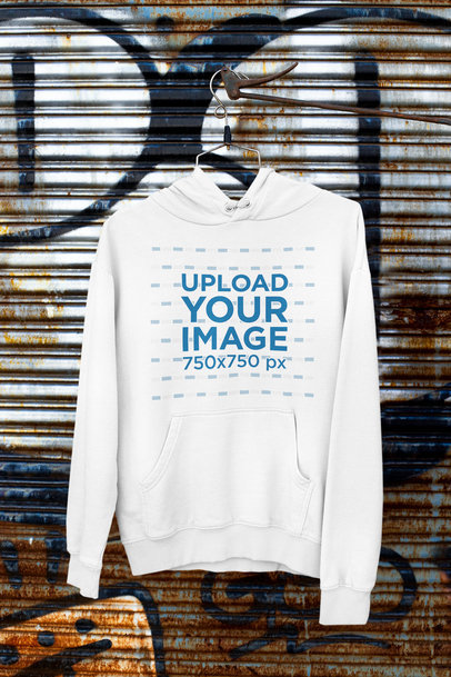 Mockup Featuring a Pullover Hoodie Hanging by a Rusty Fence m448