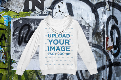 Mockup of a Hanged Hoodie by a Graffiti Wall m428