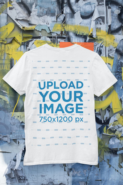 Mockup of a T-Shirt Hanging on a Wall with Old Posters and Graffiti m431