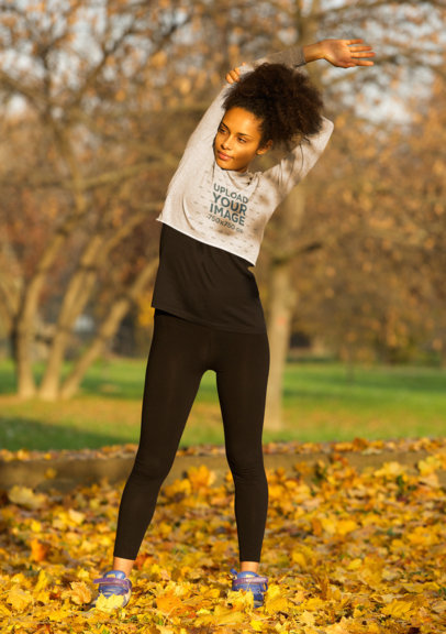 Crop Top Hoodie Mockup of a Female Runner Standing on Dry Leaves 41531-r-el2