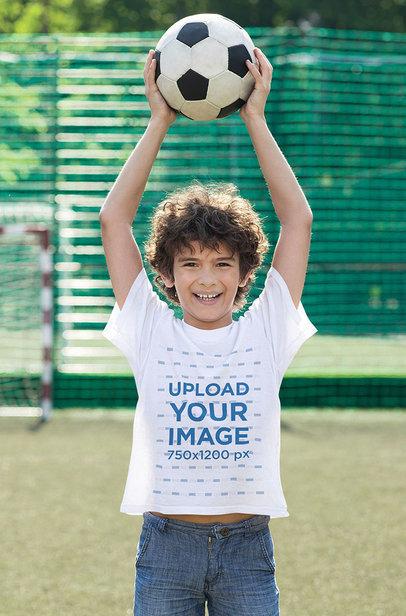 T-Shirt Mockup of a Happy Boy Holding a Soccer Ball Over His Head 43111-r-el2