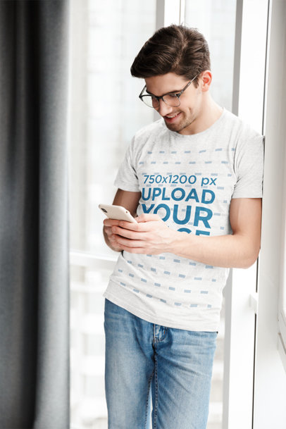 Heathered T-Shirt Mockup of a Happy Man Texting 44340-r-el2