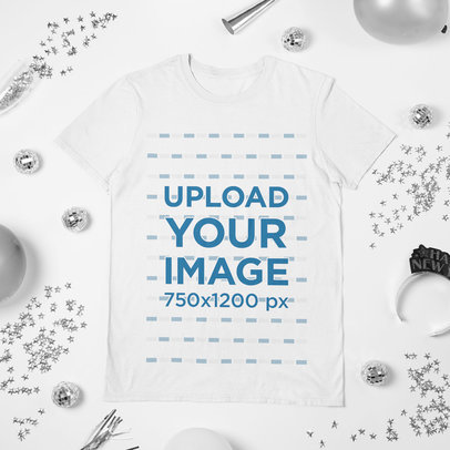 Mockup of a Round Neck T-Shirt Flat Laid on a New Year's Eve-Decorated Surface m279