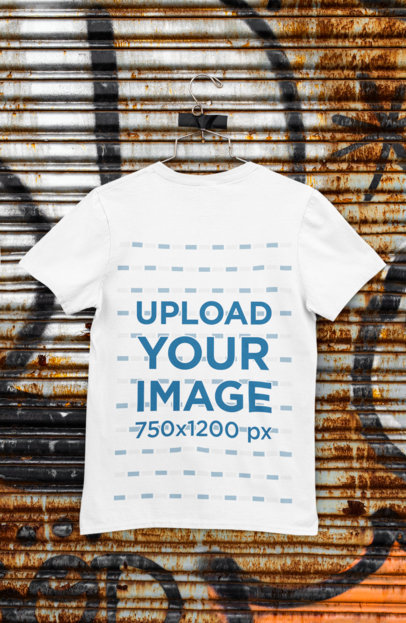 Back-View Mockup of a T-Shirt Hanged on a Rusty Steel Shutter M453