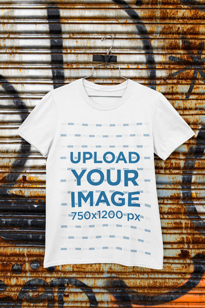 Mockup of a T-Shirt on a Hanger Taped to a Metal Shutter m452