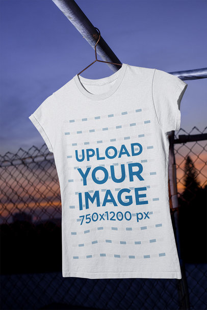 Mockup of a Women's T-Shirt Hanging in a Urban Scenario m485