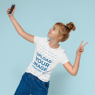 T-Shirt Mockup of a Girl Taking a Selfie in a Studio 45056-r-el2