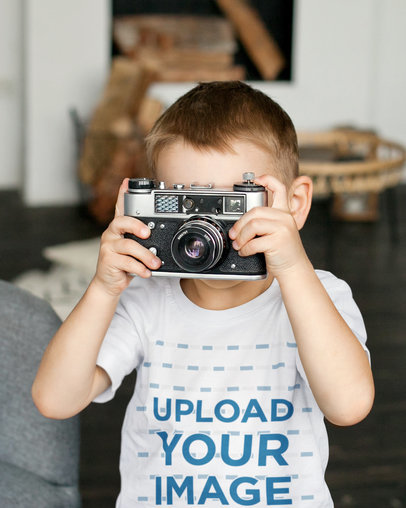 T-Shirt Mockup of a Boy Taking a Picture With an Old Camera 45037-r-el2