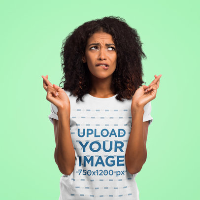 T-Shirt Mockup of a Worried Woman Posing With Her Fingers Crossed 45061-r-el2