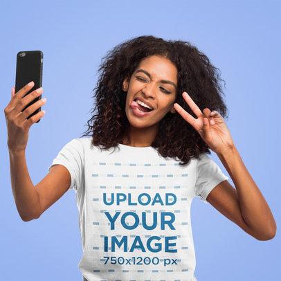 T-Shirt Mockup of a Woman Taking a Selfie in a Studio 45063-r-el2