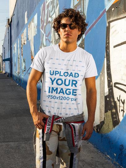 Streetwear-Styled T-Shirt Mockup Featuring a Man in an Urban Setting m521