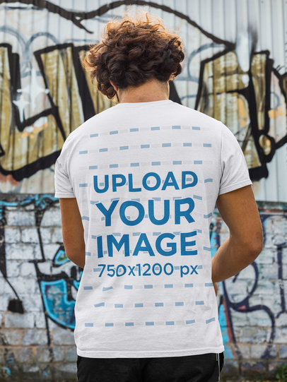 Back-View T-Shirt Mockup of a Man in Front of a Wall with Graffiti m520