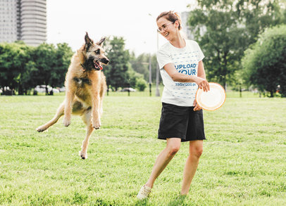 T-Shirt Mockup of a Happy Woman Playing with Her Dog at a Park 45251-r-el2