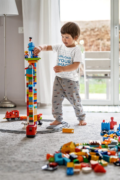 T-Shirt Mockup of a Little Boy Playing with Toys in His Room 45250-r-el2