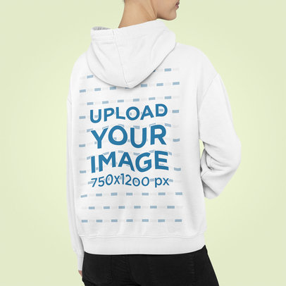 Back View Mockup of a Woman Wearing a Customizable Hoodie at a Studio m850