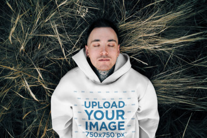Hoodie Mockup Featuring a Man Lying on the Grass 45621-r-el2