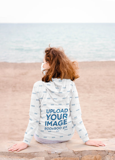 Mockup of a Woman Wearing a Hoodie While Staring at the Beach 45616-r-el2