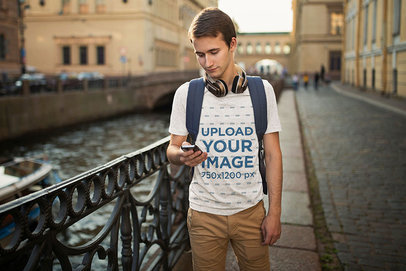 T-Shirt Mockup of a Young Man Checking His Phone in the Street 45596-r-el2