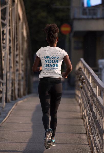 Activewear T-Shirt Mockup of a Woman Running by a Bridge 45365-r-el2