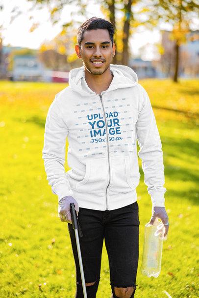 Full-Zip Hoodie Mockup Featuring a Volunteer Collecting Garbage 45157-r-el2