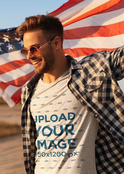 T-Shirt Mockup of a Stylish Man Holding an American Flag 45789-r-el2