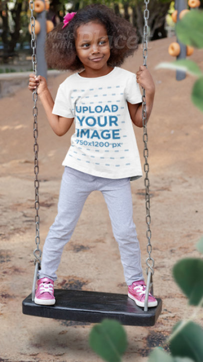 Parallax Video of a Playful Girl Wearing a T-Shirt on a Swing 2600