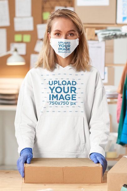 Hoodie Mockup Featuring a Woman With a Face Mask Holding a Package 45578-r-el2