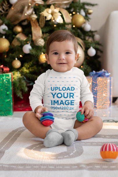 Mockup of a Baby Wearing a Long-Sleeved Onesie on Christmas M986