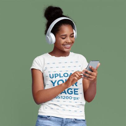 T-Shirt Mockup of a Smiling Girl with Headphones at a Studio 46086-r-el2