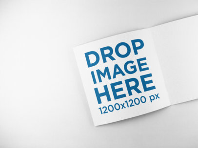 Open Booklet Mockup Lying on a Solid Backdrop a15100