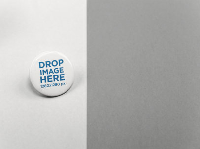 Big Button Mockup Standing on a Solid Surface of Two Colors a15133