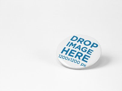 Button Mockup Lying on a Solid Color Surface a15103