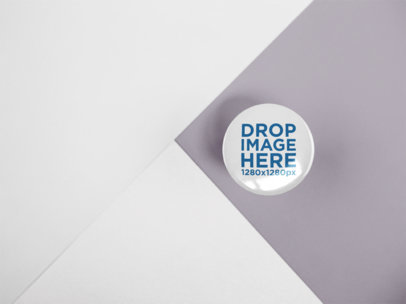 Small Button Mockup Lying on a Flat Surface Made of Three Colors a15128