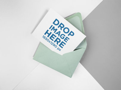 Invitation on an Envelope Mockup Lying on a Three Colors Background a15129