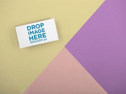 Mockup of a Business Card Lying on a Three Colors Surface a15127